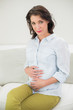Relaxed pregnant brown haired woman holding her belly