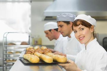 Happy female baker smiling at the camera