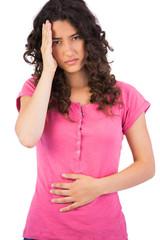 Attractive brunette having headache