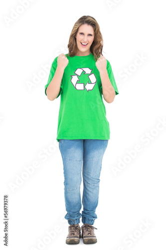 Happy young woman wearing  green shirt with recycling symbol