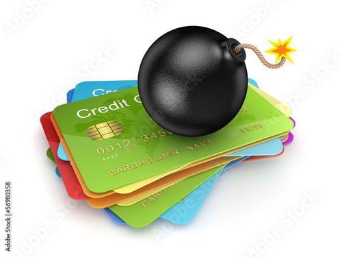 Black bomb on a stack of credit cards.