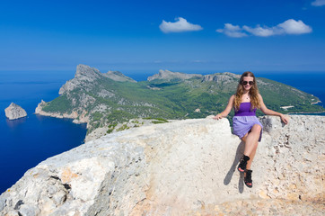 Happy teenage girl on the hills top on Majorca island