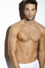 Portrait of shirtless mid adult man, studio