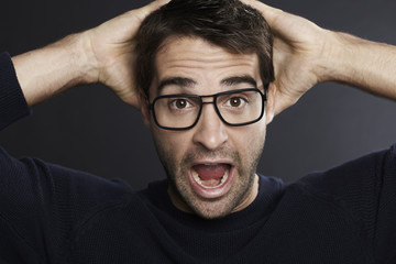 Portrait of surprised man wearing glasses