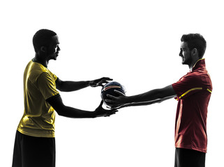 two men soccer player giving football  silhouette