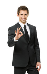 Half-length portrait of ok gesturing businessman