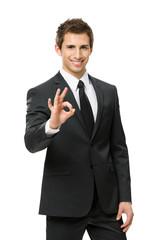 Half-length portrait of ok gesturing businessman