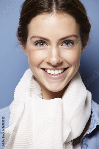 portrait of a young adult on blue background