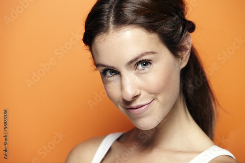 Portrait of a young woman on a orange background