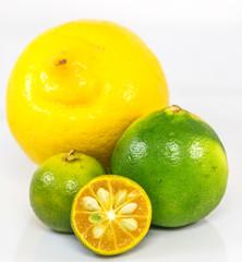 Calamansi, lime and lemon over white background