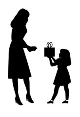 daughter giving mother a gift in silhouette