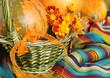Motley pumpkins in basket for Halloween