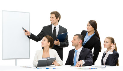 Manager showing something on screen to business people