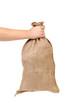 Hand holding full sack.