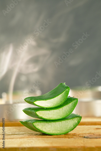 Aromatherapy with fresh aloe vera slices on wooden.