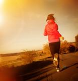 Fototapeta Young woman running