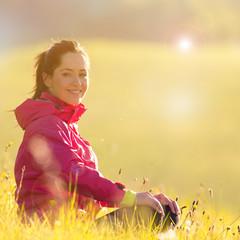 Pretty woman relaxing on a meadow