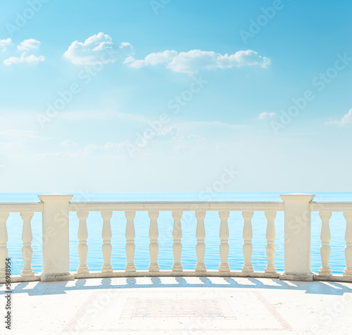 balcony near sea under cloudy sky