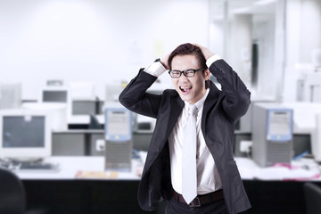 Angry businessman shouting at office