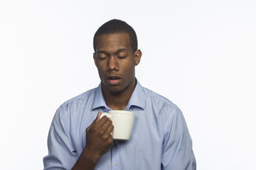 Young tired black man with coffee, horizontal