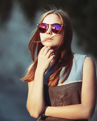teenage girl in sunglasses.