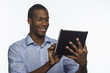 African American man typing on his tablet, horizontal