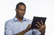 Young black man using electronic tablet, horizontal