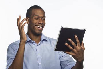 Young black man using tablet, horizontal