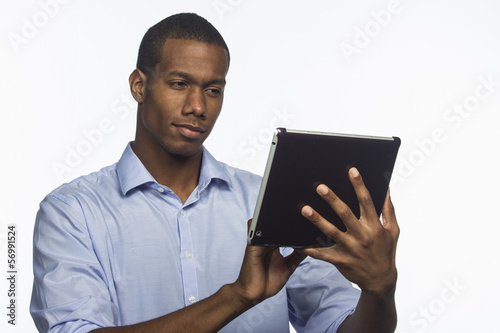 Black man typing on his electronic tablet, horizontal