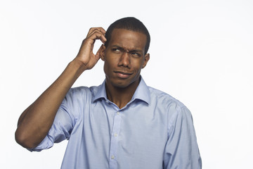 Young black man confused and scratching head, horizontal