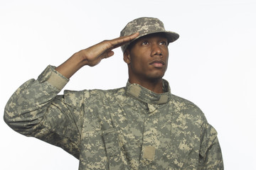 Young black military man saluting, horizontal