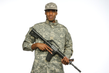Young black military man with gun, horizontal