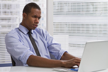 Black businessman frustrated with work, horizontal