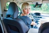 attractive woman parking her car - Fine Art prints