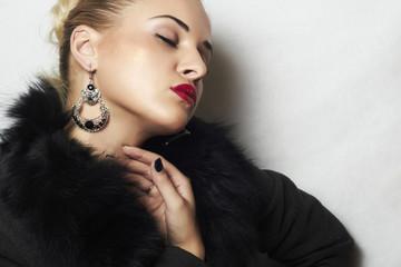 Jewelry and Beauty. beautiful blond woman.red lips