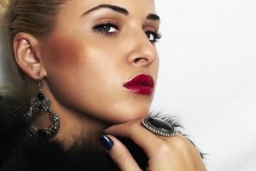 beautiful blond woman.Jewelry and Beauty.Fashion.red lips