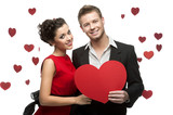 young smiling caucasian couple holding red heart