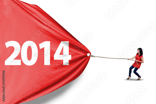 Woman pull new year of 2014 - isolated