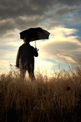 Man standing alone in the countryside