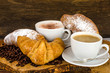 Delicious breakfast with coffee, cappuccino and croissants
