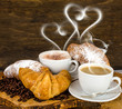 Croissants and coffee with heart- shaped steam