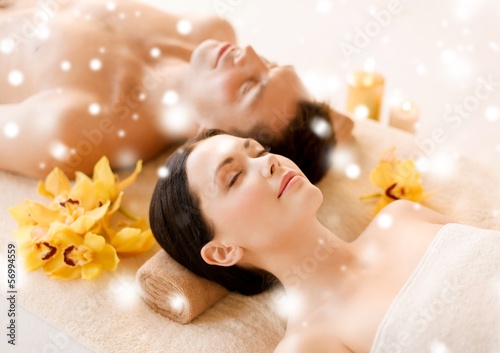 couple in spa salon lying on the massage desks