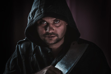 portrait of a maniac killer with a hatchet