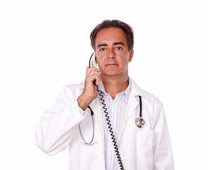 Professional medidal doctor talking on phone