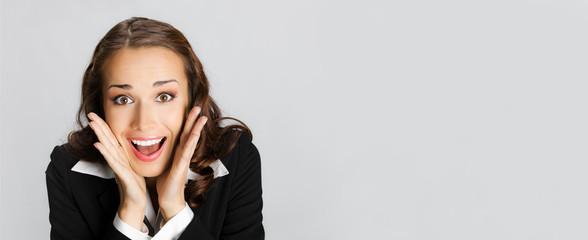 Surprised businesswoman, on gray