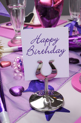 Pink and purple theme birthday party table