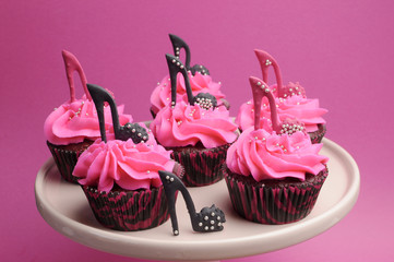 Female high heel shoes decorated pink cupcakes