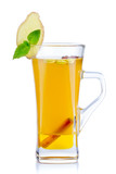 Glass of hot fruit tea with fresh mint and spices isolated