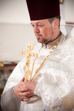 Orthodox priest holding candles