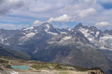 Cloudscape mountain scenery in the Alps in summer, Matterhorn.